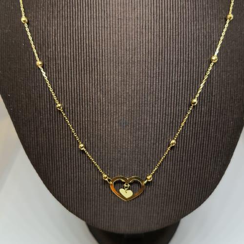 Zlatna ogrlica od žutog zlata s privjeskom dva srca