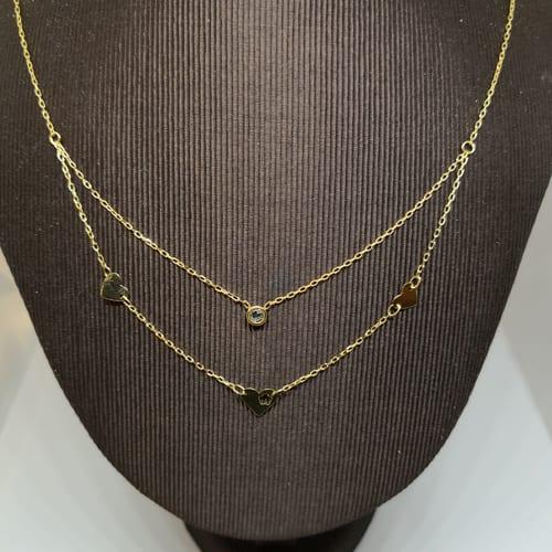 Dvostruka zlatna ogrlica sa simbolima srca